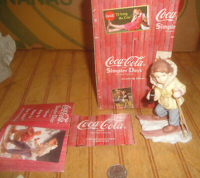 Enesco Coca Cola Simpler Days Always Keep As Warm As Your Spirts Skiing Figurine