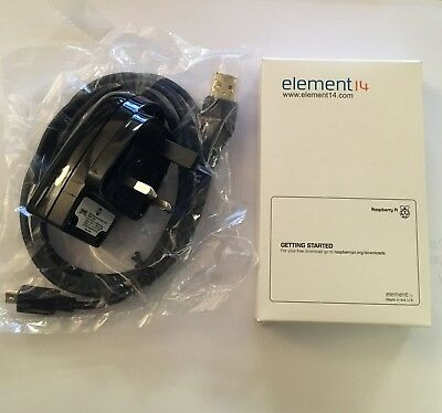Raspberry Pi Model B (2011) and USB Mains Adapter Brand New In Box board