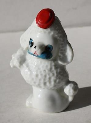 White French Poodle Dog Porcelain Figurine with Red Hat and Blue Slipper Vintage