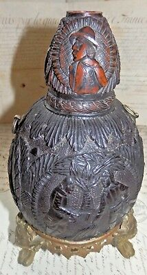 A rare carved 'Bugbear' Coconut Flask with amazing historical detail circa 1830