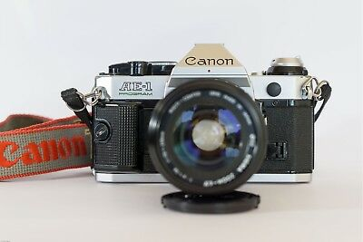 CANON AE-1 PROGRAM Analog + 70-210 mm Macro Sigma Lens,  in very good condition.