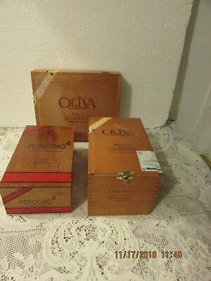 3 nice solid wood cigar boxes with hinged lids. Perdomo & Oliva