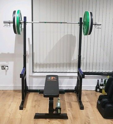 squat rack with spotter arms. Adjustable height and width. weight lifting. Power