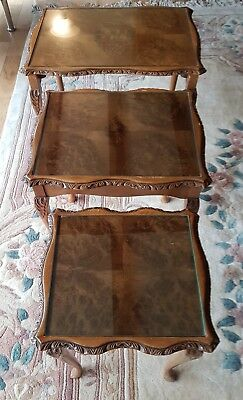 A beautiful nest of three carved burr walnut coffee tables - Vintage quality