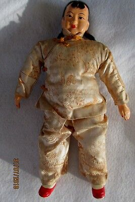 Old Oriental Stuffed Doll With Composition Head In Gold Silk Outfit