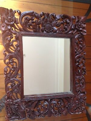 Antique hand carved Indonesian mirror.