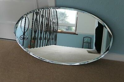 """Antique large oval mirror Early 20th Century bevelled and scalloped edge 27""""x16"""