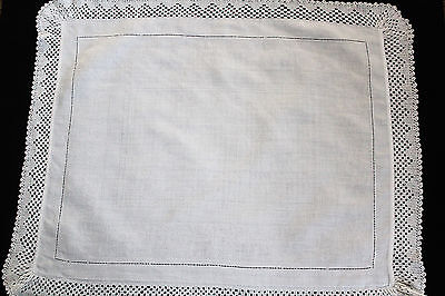 Vintage linen cloth with dotted centre and crochet edge.