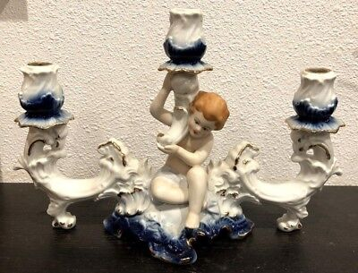 Porcelain Putto Cherub Three Candle Candelabra Made in Romania Mid 20th c.