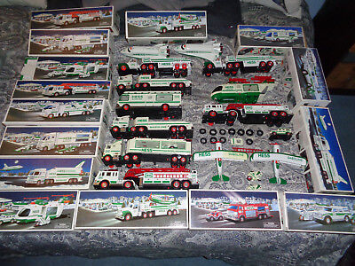 Lot of 9 Hess Toy Trucks, Vehicles with boxes.