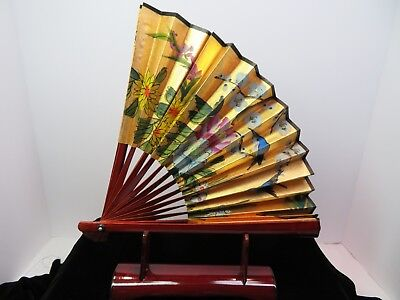 Beautiful Hand Painted Wood Fan On Gold Paper Sits In Matching Wood Base