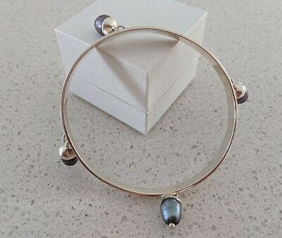 sterling Silver oval Bangle with four hanging black freshwater pearls 6.5 cms