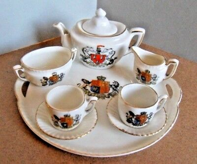GEMMA MINATURE TEASET,NEWCASTLE upon TYNE, 9 PIECES. CRESTED CHINA.TEAPOT DAMAGE