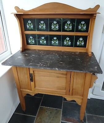Victorian pine antique washstand, green tiled back with marble top and side rail