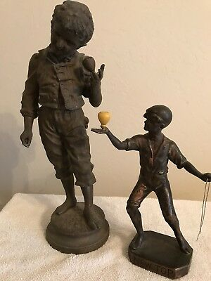Vintage La Toupie Statue depicting a boy spinning top.  Lot of 2 Statues. Good