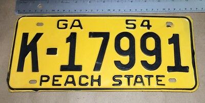 1954 GEORGIA PEACH STATE CAR TAG LICENSE PLATE  BLACK YELLOW New old stock GA