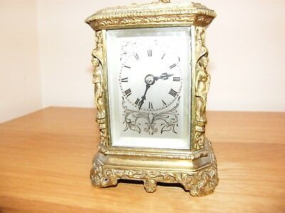 Beautiful heavily embossed and engraved brass 4 glass London made carriage clock
