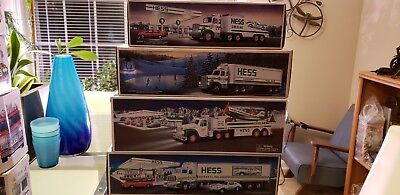 Look!!! Lot Of 8 Hess Toy Trucks (4- Used And 4-New)!!