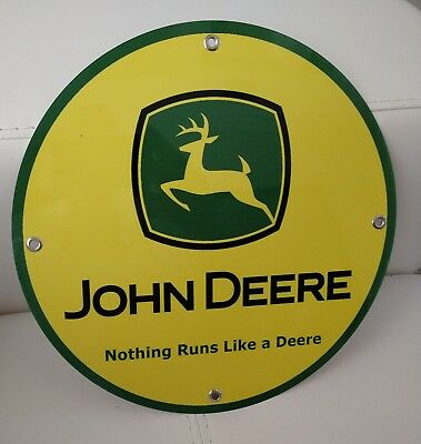 John Deere advertising sign...~12 inch diameter