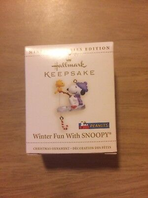 The 2006 Peanuts Hallmark WINTER FUN WITH SNOOPY Christmas Ornament