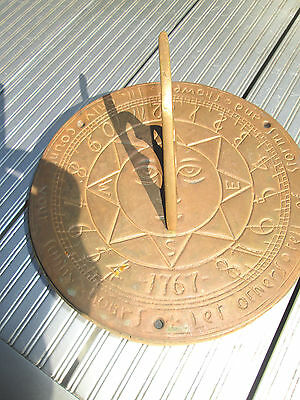 Old solid brass sun dial