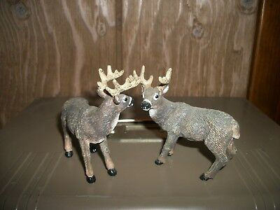 Two Buck Figurines