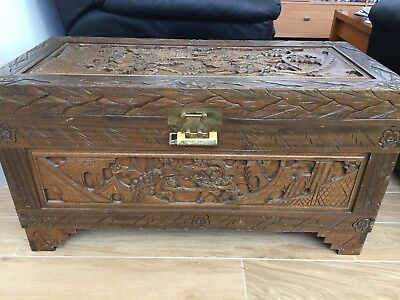 Vintage carved camphor wood chest with original brass lock and key; exc cond