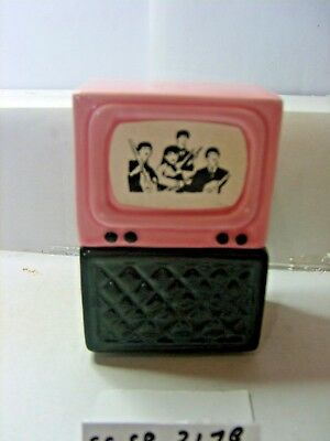 tv with beetles  salt and pepper shakers