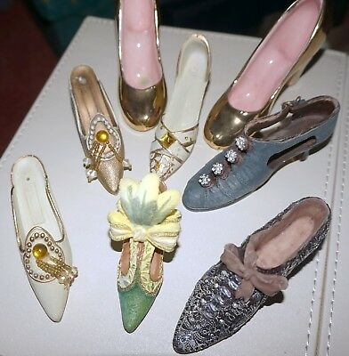 7 china shoes one are pair  they are all different designs look good