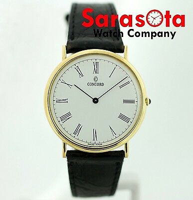 Vintage Concord 14k Yellow Gold White Roman 32mm Round Swiss Quartz Wrist Watch