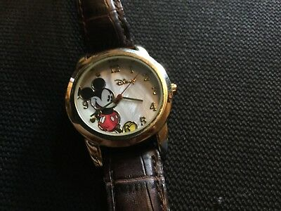 mickey mouse watch, by disney, leather wrist-band, gold face and number's