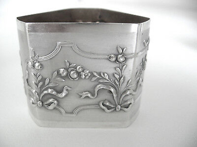 Very ornate, art nouveau sterling silver napkin ring.  Unusual triangular shape