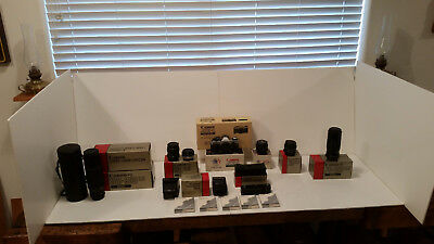 Canon AE-1 Program W/5 lenses, 17 filters, all literature/boxes, carrying cases