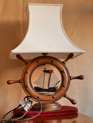 Antique wooden lamp in the form of a ships Wheel with model sailing ship.