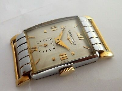 Vintage LONGINES ART DECO GOLD STEEL FANCY LUGS. 9LT. Swiss made
