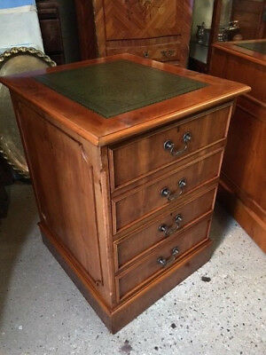 A yew wood Filing cabinet / chest of drawers with leather green top