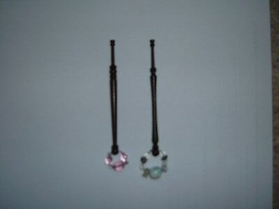 A lovely pair of wooden bobbins with spangles