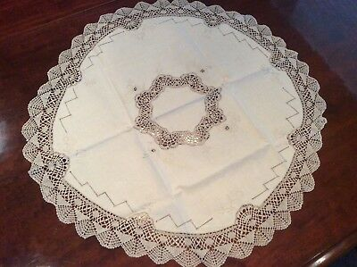 Table cover circular 28'' dia ecru hand embroidered and bobbin  lace fringe.