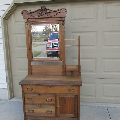 Antique Hotel Washstand with beveled mirror and 3 towel bars