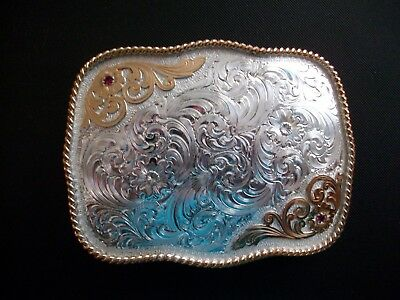 Large Two Toned Montana Silversmiths Belt Buckle With Ruby Stones