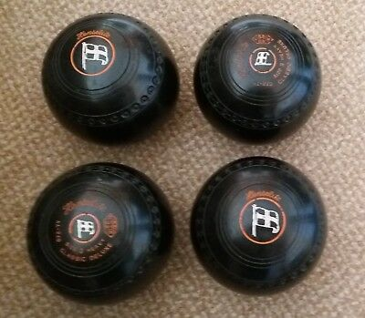 Four Henselite Classic Delux Black Size 3 with red rings & grips. Dated 2003