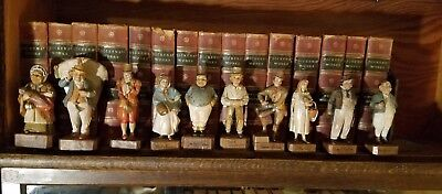 10 Charles Dickens' wooden figurines with a 15 volume Charles Dickens Book set