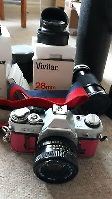 Canon AE-1 35mm SLR Film Camera with FD 50mm lens Kit leather wrapped, extra's.