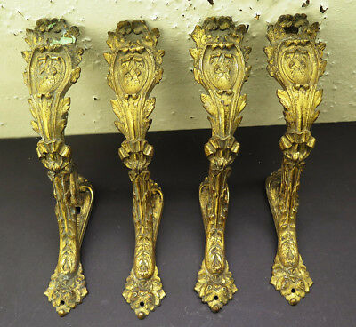 Four Antique Gilt Brass Rococo Curtain Pole Holders