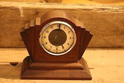 vintage Art Deco style smiths car clock mounted in skyscraper style wooden case