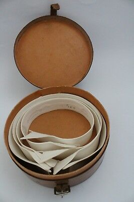 Vintage tan leather collar box including 4 collars.