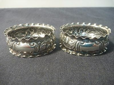 """Pair of highly embossed """"frill edge"""" Sterling Silver napkin rings Ca. 1904"""