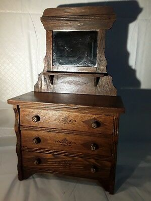 Antique salesman or doll three drawer dresser with shelf and mirror back