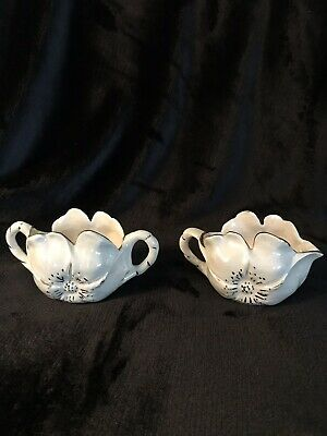 Hand made iridescent creamer and sugar bowl in the shape of a flower