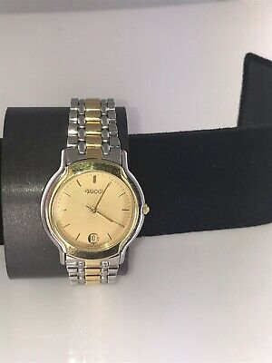 cfaaf4207d1 Estate Gucci Gold Plated And Stainless Steel Date Wrist Watch